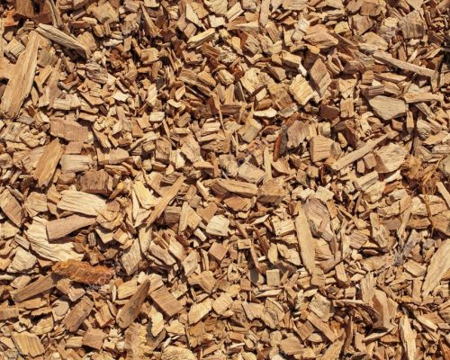 depositphotos_96832762-stock-photo-wood-chips-texture-wooden-biomass